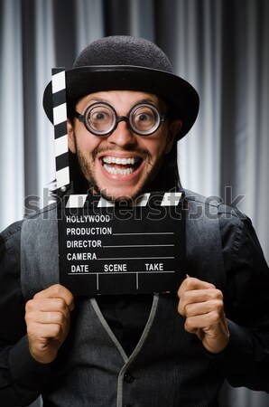 Funny gentleman in striped suit isolated on white Stock photo © Elnur