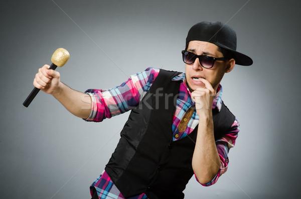 Grappig man zingen karaoke disco bril Stockfoto © Elnur