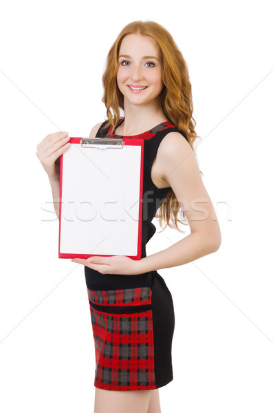 Stock photo: Cute girl in squared dress holding paper isolated on white