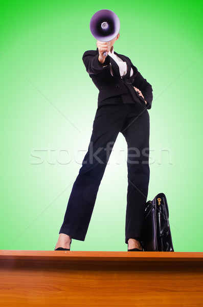 Businesswoman shouting through loudspeaker Stock photo © Elnur