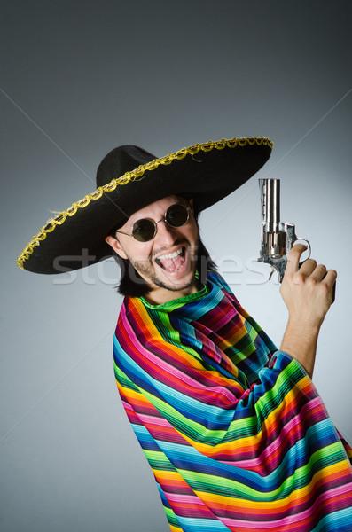 Mexican with gun wearing sombrero Stock photo © Elnur