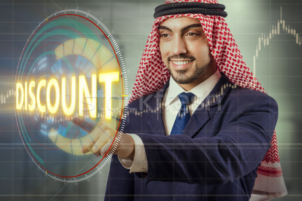 Arab man pressing buttons in sale concept Stock photo © Elnur
