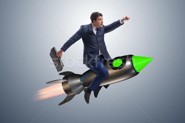 Erkek işadamı uçan roket iş şehir Stok fotoğraf © Elnur