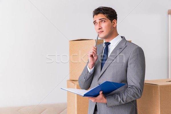 Man signing for the delivery of boxes Stock photo © Elnur