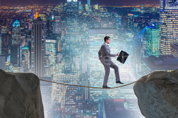 The businessman walking on tight rop in business concept Stock photo © Elnur