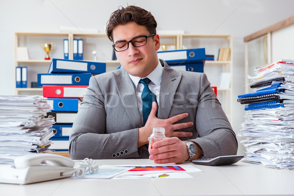 The businessman taking pills to cope with stress Stock photo © Elnur