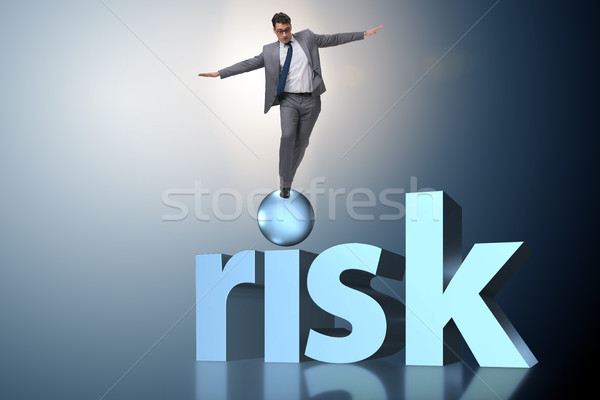 The young businessman in business risk and uncertainty concept Stock photo © Elnur