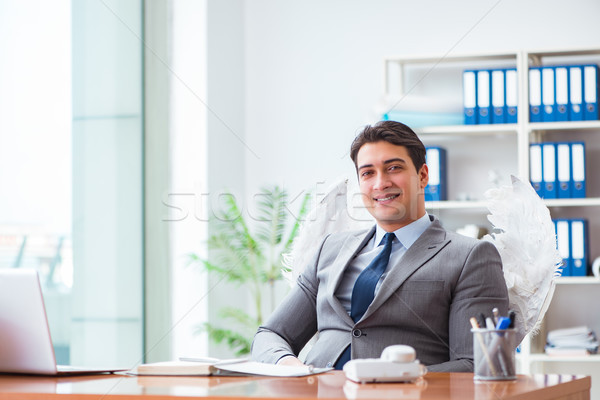 Angel investor concept with businessman and wings Stock photo © Elnur