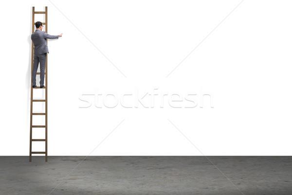 Empresario escalada escaleras aislado blanco hombre Foto stock © Elnur