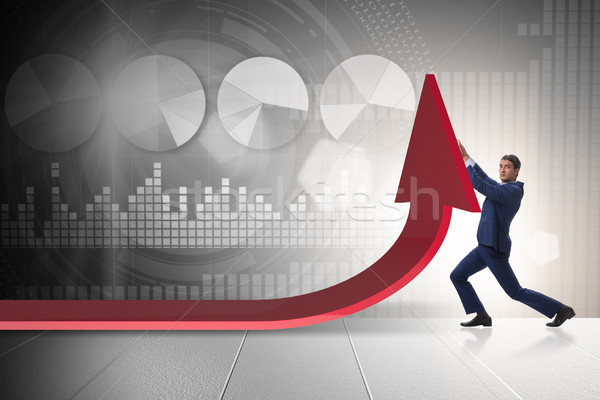 Businessman supporting growtn in economy on chart graph Stock photo © Elnur