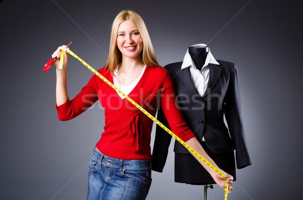 Jovem alfaiate isolado branco moda trabalhar Foto stock © Elnur