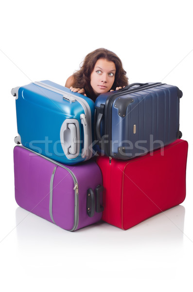 Woman preparing for vacation with suitcases isolated  on white Stock photo © Elnur