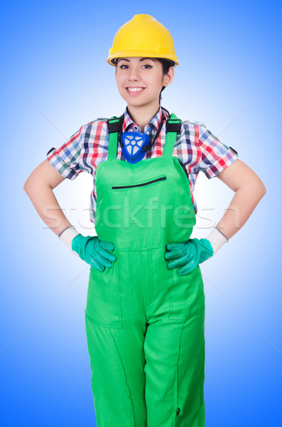 Young woman in green coveralls Stock photo © Elnur