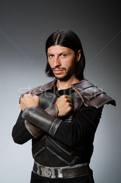 Enojado guerrero oscuro hombre traje diversión Foto stock © Elnur