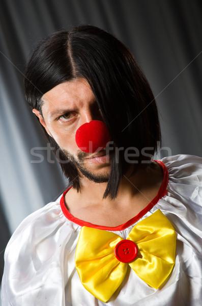 Sad clown against grey background Stock photo © Elnur