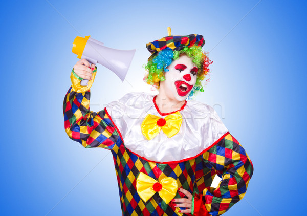Stock photo: Clown with loudspeaker on white