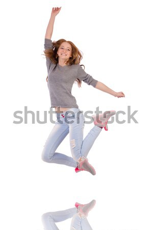 Cute smiling girl in gray blouse and jeans isolated on white Stock photo © Elnur