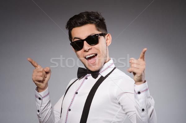 Fiatal elegáns férfi visel nap szemüveg Stock fotó © Elnur