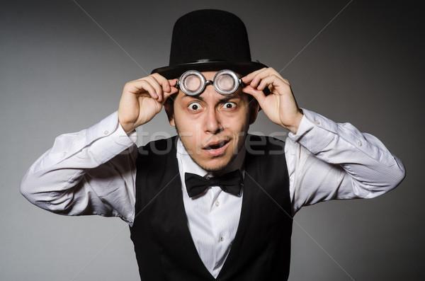 Jonge man klassiek zwarte vest hoed grijs Stockfoto © Elnur