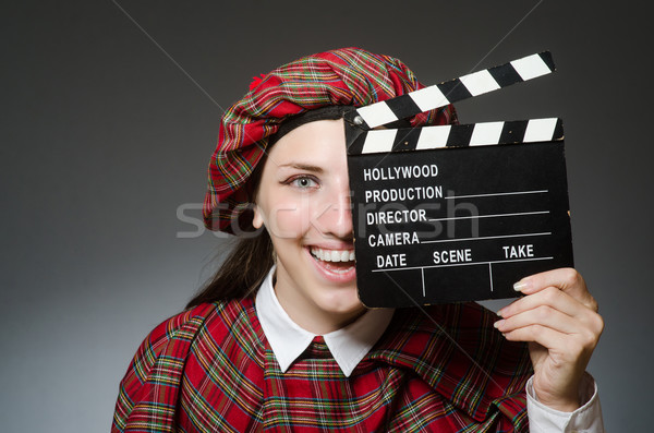 Stock photo: Woman in scottish clothing in movie concept