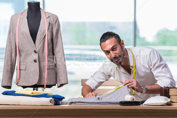 Fiatal szabó dolgozik új ruházat terv Stock fotó © Elnur
