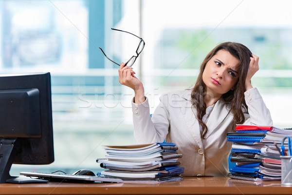 Businesswoman sitting at the office desk Stock photo © Elnur