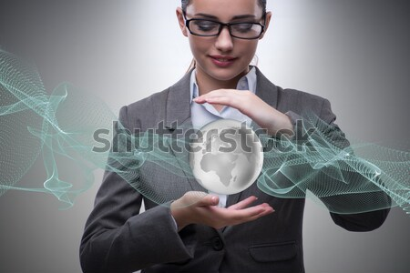 Stock photo: Woman holding crystall ball isolated on white