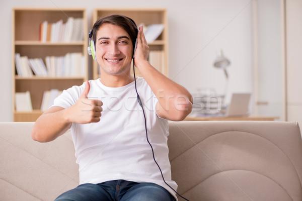 Handsome man listening to the music Stock photo © Elnur