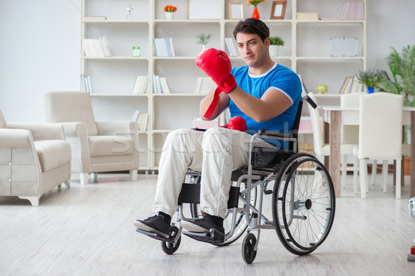 Disabled boxer at wheelchair recovering from injury Stock photo © Elnur