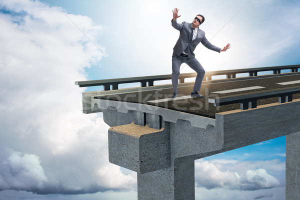 Businessman in uncertainty concept with broken bridge Stock photo © Elnur
