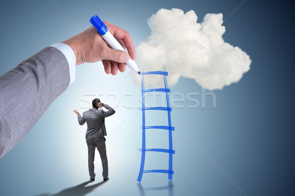 Businessman climbing career ladder in business concept Stock photo © Elnur