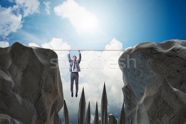 Biznesmen wiszący liny niebezpieczeństwo działalności pracownika Zdjęcia stock © Elnur