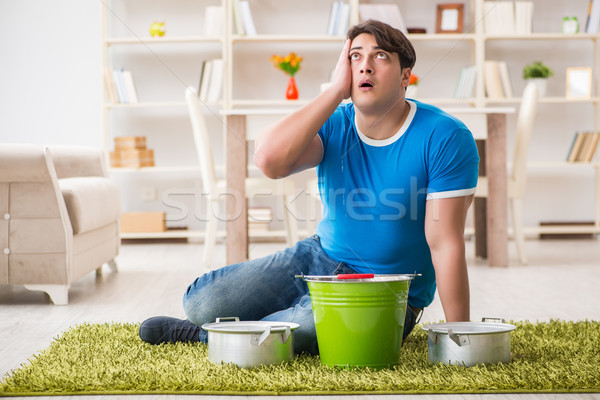 The man at home dealing with neighbor flood leak Stock photo © Elnur