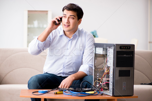 Happy customer resolving his computer problem Stock photo © Elnur