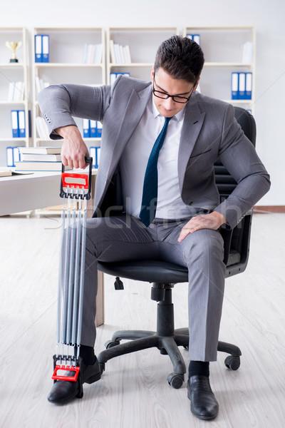 Genç işadamı egzersiz elastik ofis adam Stok fotoğraf © Elnur