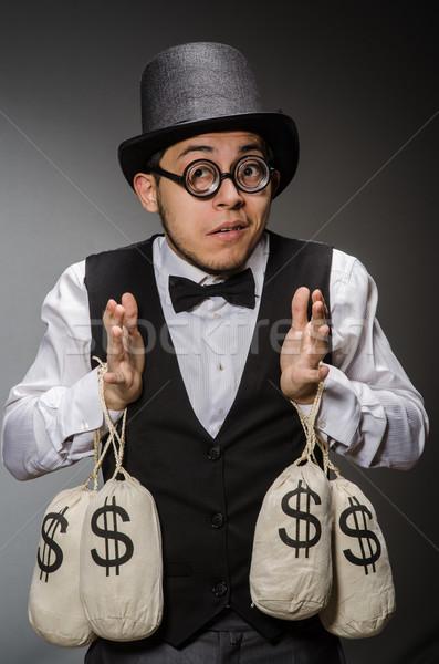 Stockfoto: Man · geld · business · veiligheid · zakenman · zak