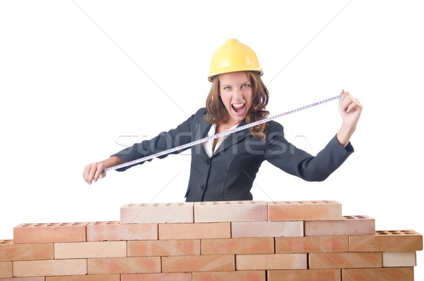 Woman builder measuring isolated on the white Stock photo © Elnur