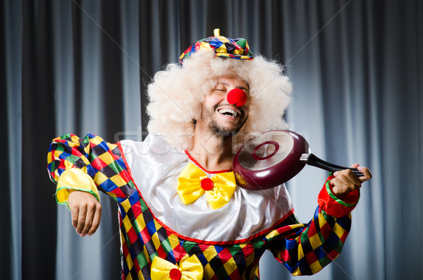 Angry clown with frying pan Stock photo © Elnur