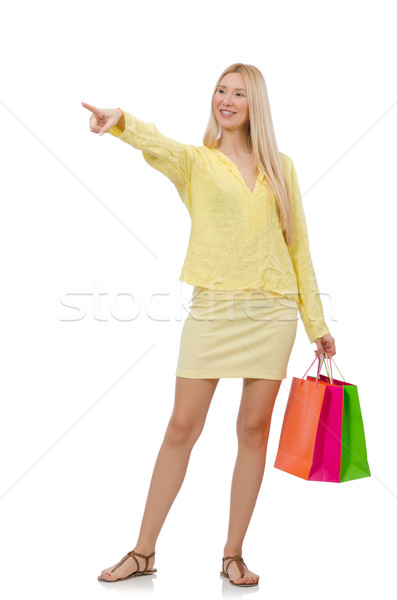 Pretty young woman in summer yellow clothing isolated on white Stock photo © Elnur