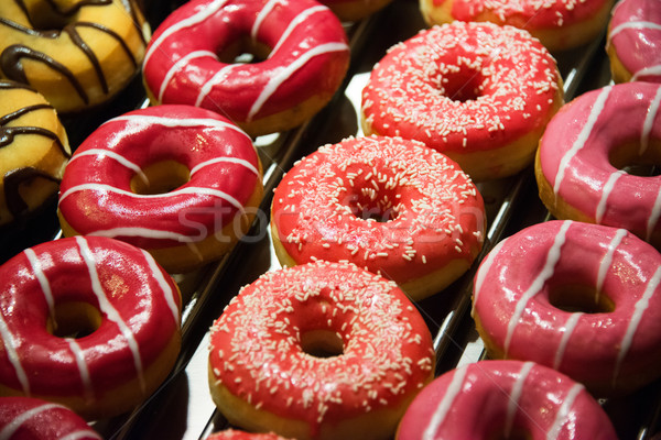 Sweet donuts arranged at display Stock photo © Elnur