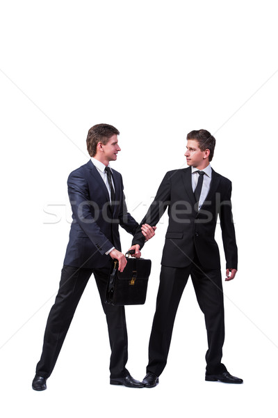 Stock photo: Two twins businessmen arguing with each other isolated on white