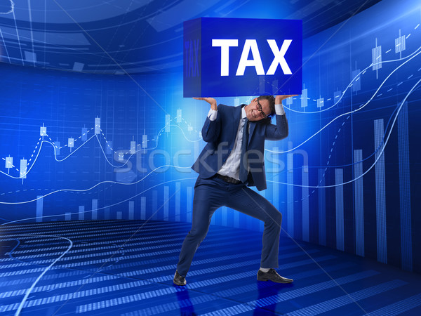 The man under the burden of tax payments Stock photo © Elnur