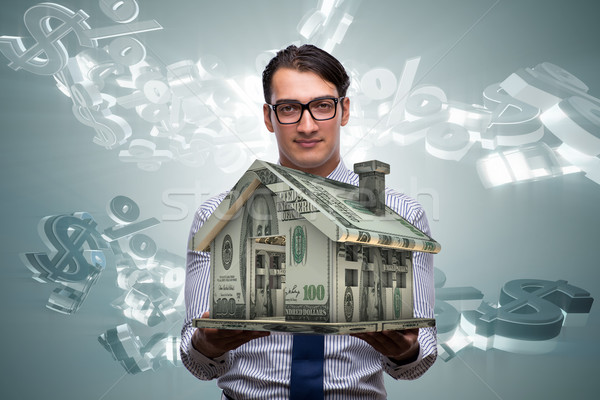Young handsome businessman in mortgage concept Stock photo © Elnur