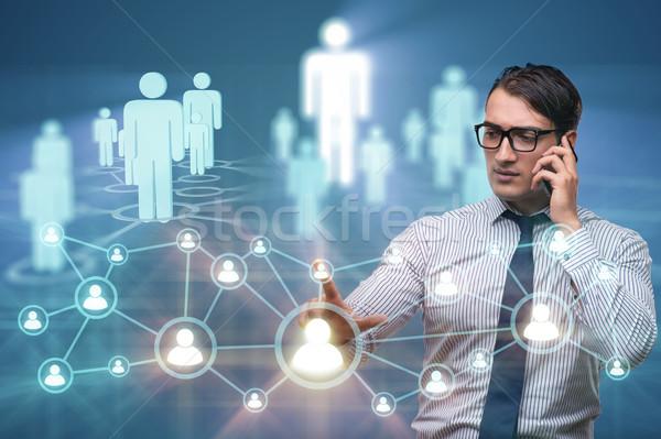 Stockfoto: Jonge · man · praten · mobiele · sociale · netwerken · business · technologie