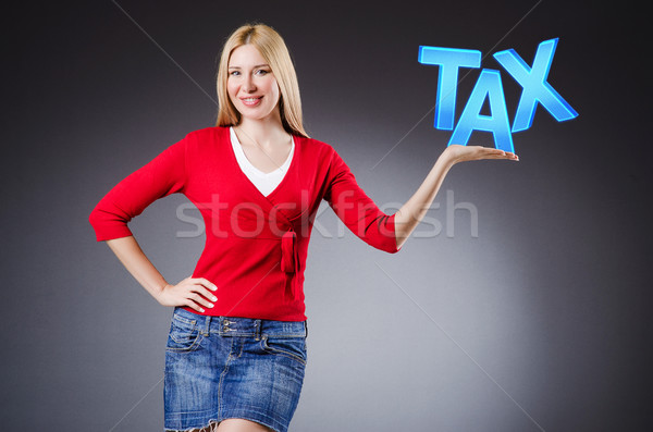 Businesswoman in tax business concept Сток-фото © Elnur