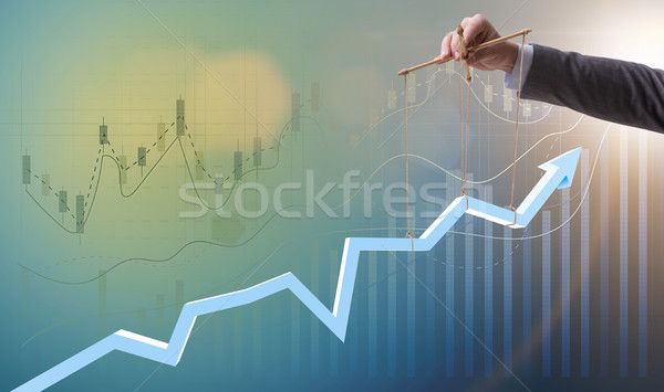Businessman keeping the growth in economy Stock photo © Elnur