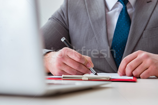 Businessman taking notes at the meeting Stock photo © Elnur