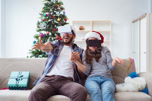Happy family using virtual reality VR glasses during christmas Stock photo © Elnur