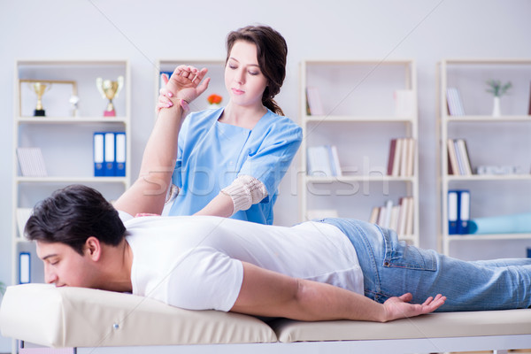 Female chiropractor doctor massaging male patient Stock photo © Elnur