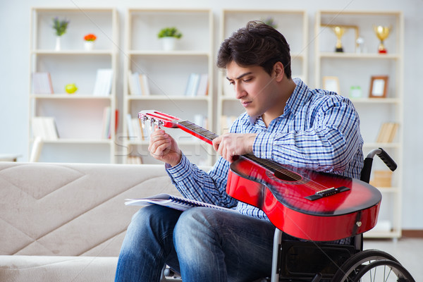Niepełnosprawnych człowiek gry gitara domu student Zdjęcia stock © Elnur